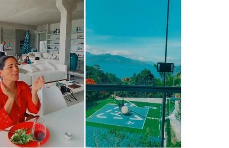 Gloria Pires e, ao fundo, garçom servindo as visitas; e heliponto da mansão Reprodução/Instagram