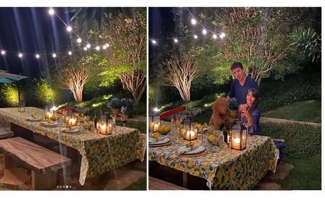 Suzana e o filho, Romeo, na mesa posta no gramado Reprodução