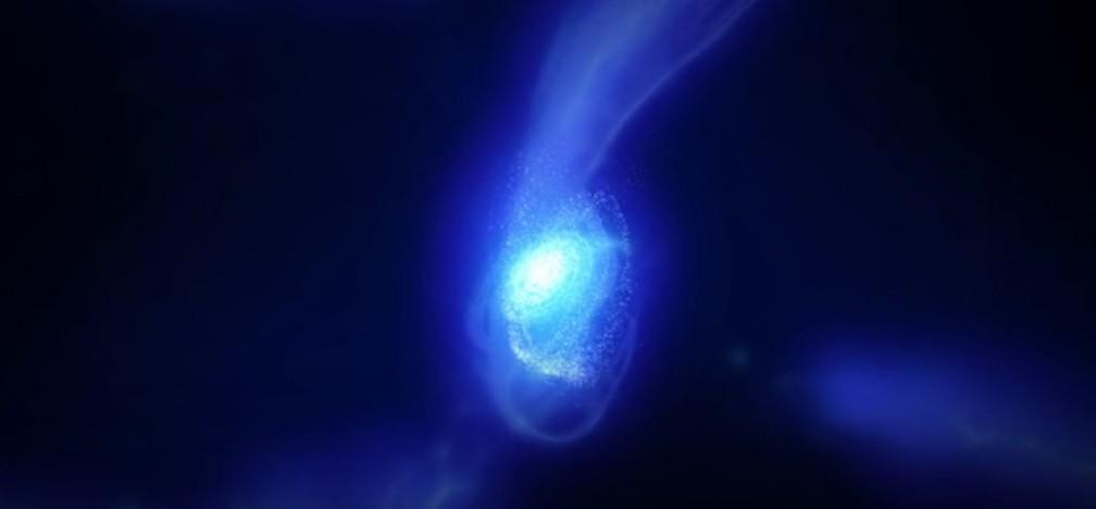 Representação gráfica da galáxia MACS1149-JD1. Gás na galáxia é soprado pelo vento estelar (Foto: ALMA (ESO/NAOJ/NRAO))