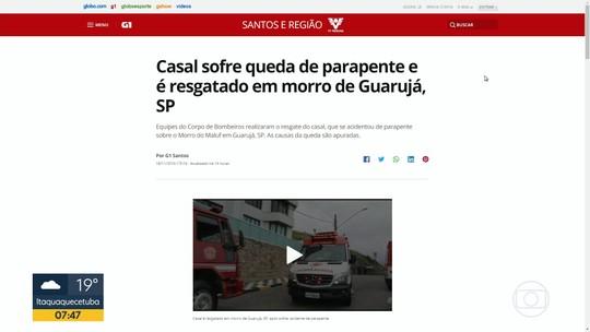 Casal é resgatado pelos bombeiros depois de cair de parapente no Guarujá