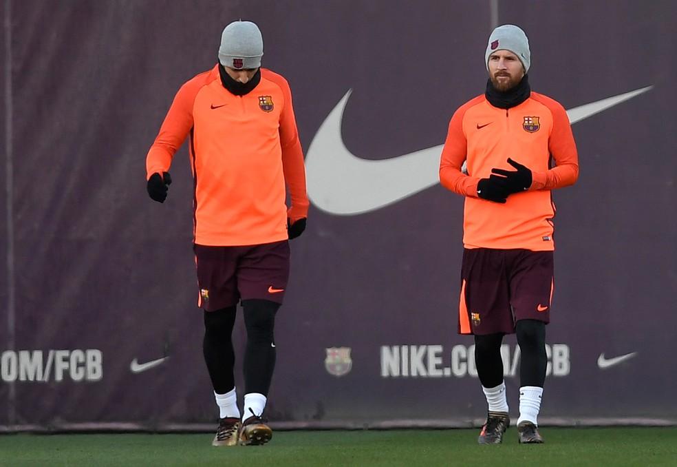 Messi e Suárez durante treino do Barça: dupla deve ir a campo nesta terça (Foto: AFP)