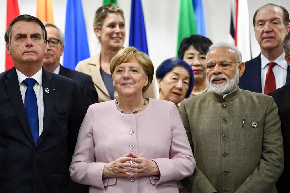 O presidente Jair Bolsonaro, a chanceler alemã Angela Merkel e o primeiro-ministro indiano Narendra Modi em encontro do G20. — Foto: Brendan Smialowski / AFP