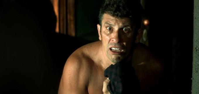Milhem Cortaz interpreta o delegado Machado (Foto: TV Globo)