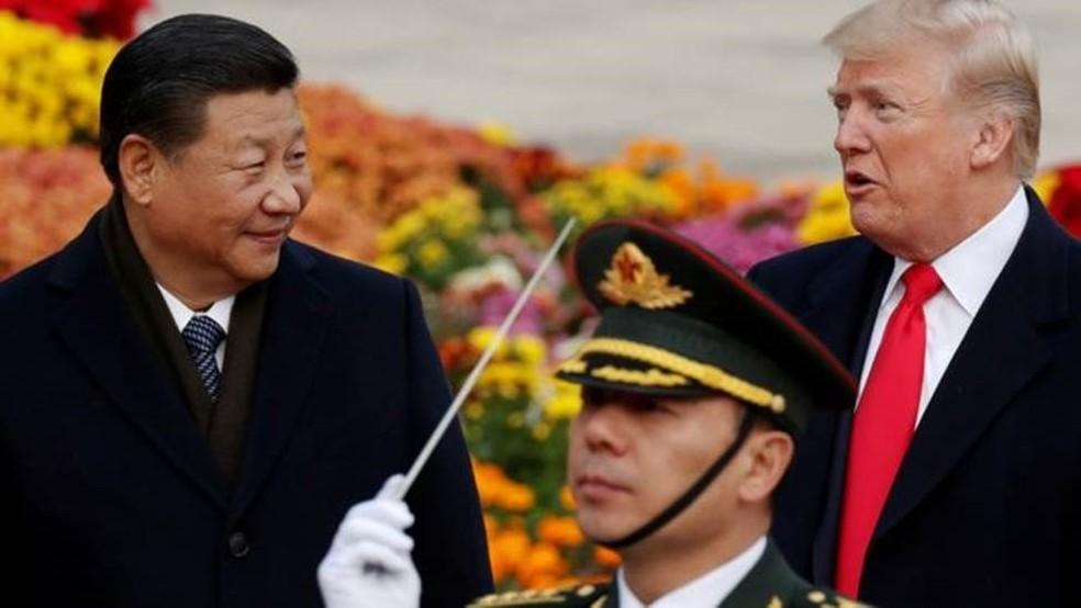 Donald Trump e Xi Jinping durante encontro na China  — Foto: DAMIR SAGOLJ/REUTERS