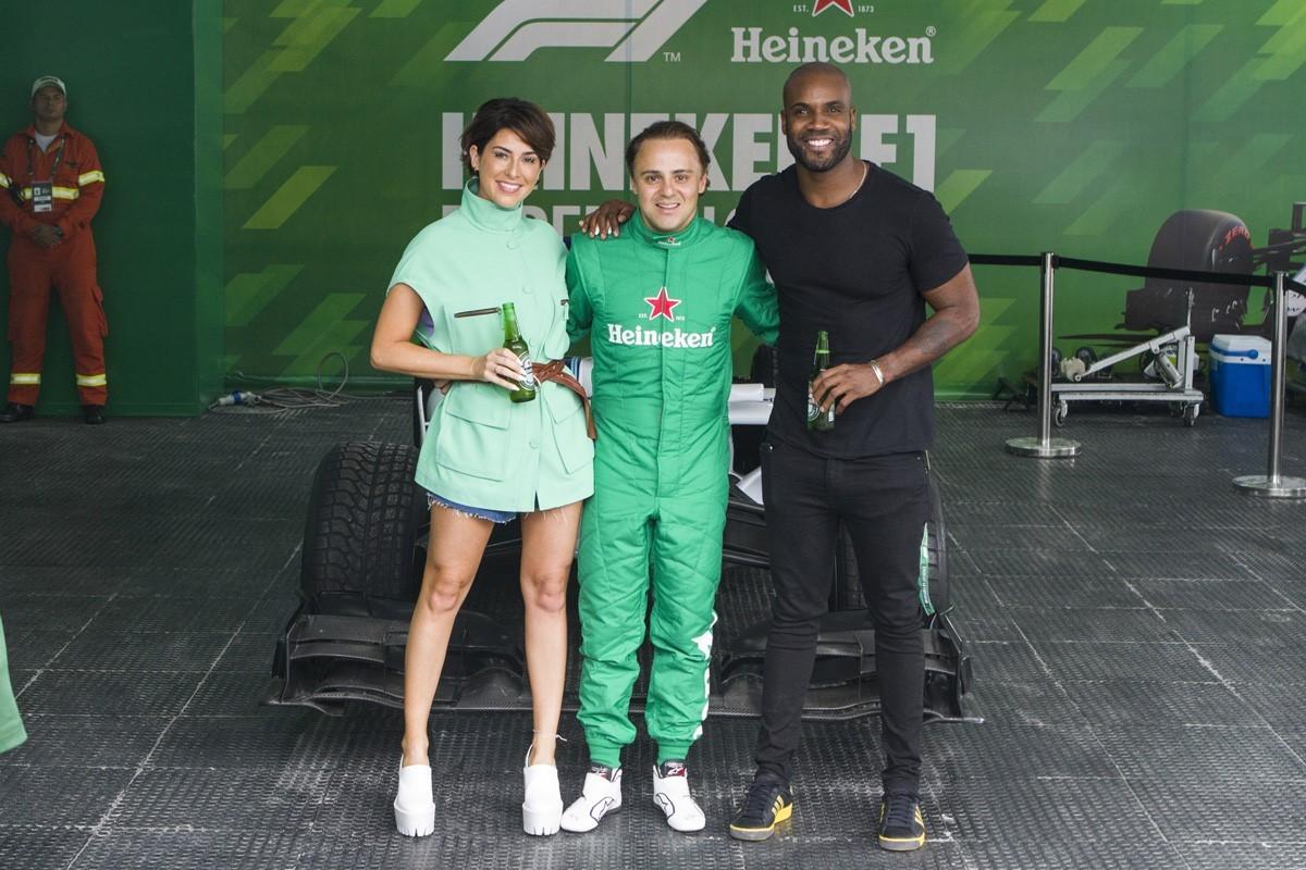 Fernanda Paes Leme e Rafael Zulu aproveitaram para tietar o piloto Felipe Massa (Foto: Carlos Miller)