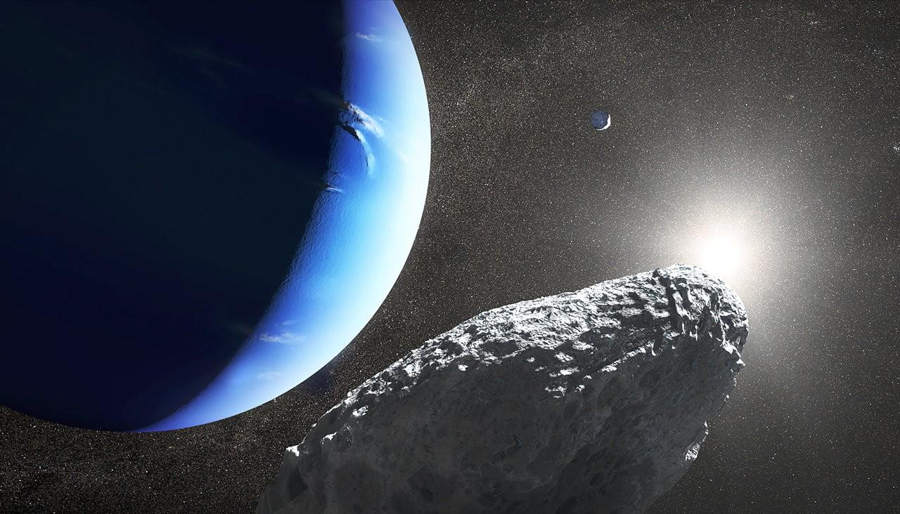 Netuno ao lado de uma de suas luas (Foto: NASA/ Reprodução)