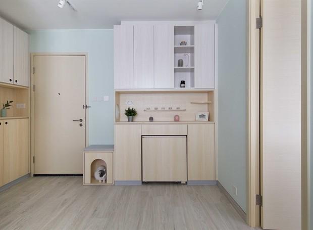 O armário conta com casinha para o gato e espaços de armazenamento (Foto: Sim-Plex/ Reprodução)