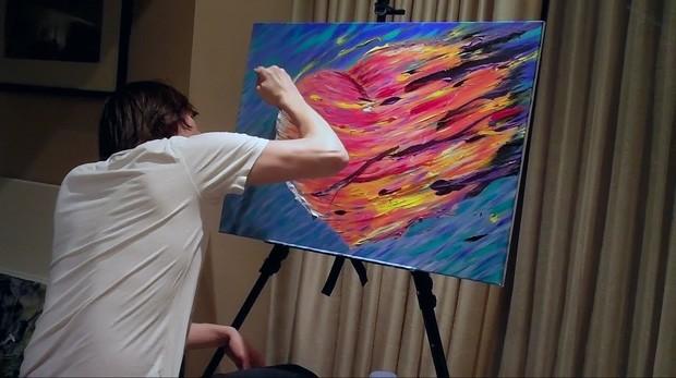 """Jim Carrey fala sobre pintura e depressão em sue minidocumentário """"Jim Carrey: I needed Color"""". Na foto, o ator trabalha em um quadro sobre um coração partido (Foto: Reprodução )"""