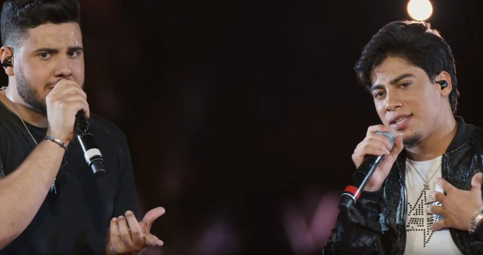 Dupla Netto e Henrique durante apresentação: Henrique morreu em acidente — Foto: Divulgação