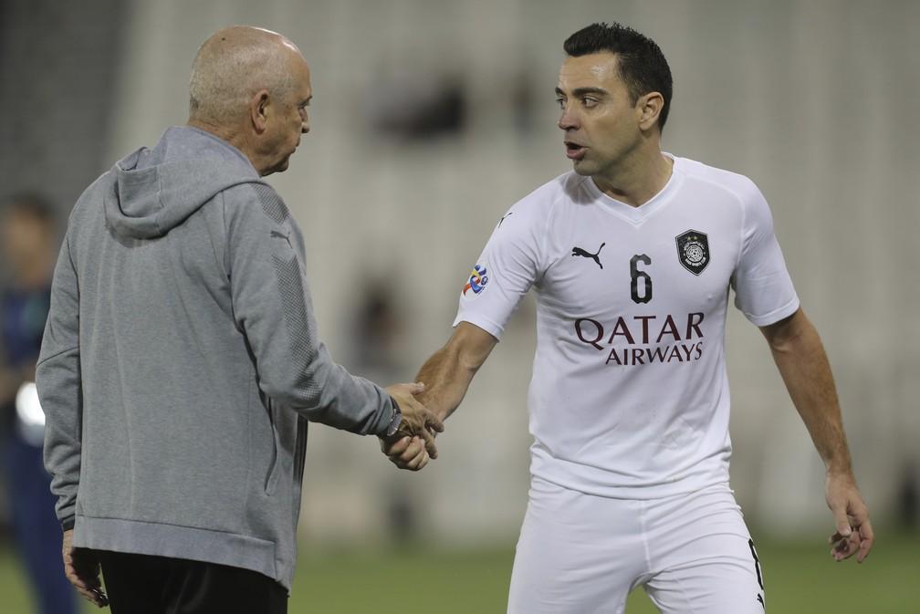 Jesualdo Ferreira e Xavi no Al Sadd, do Catar — Foto: AFP