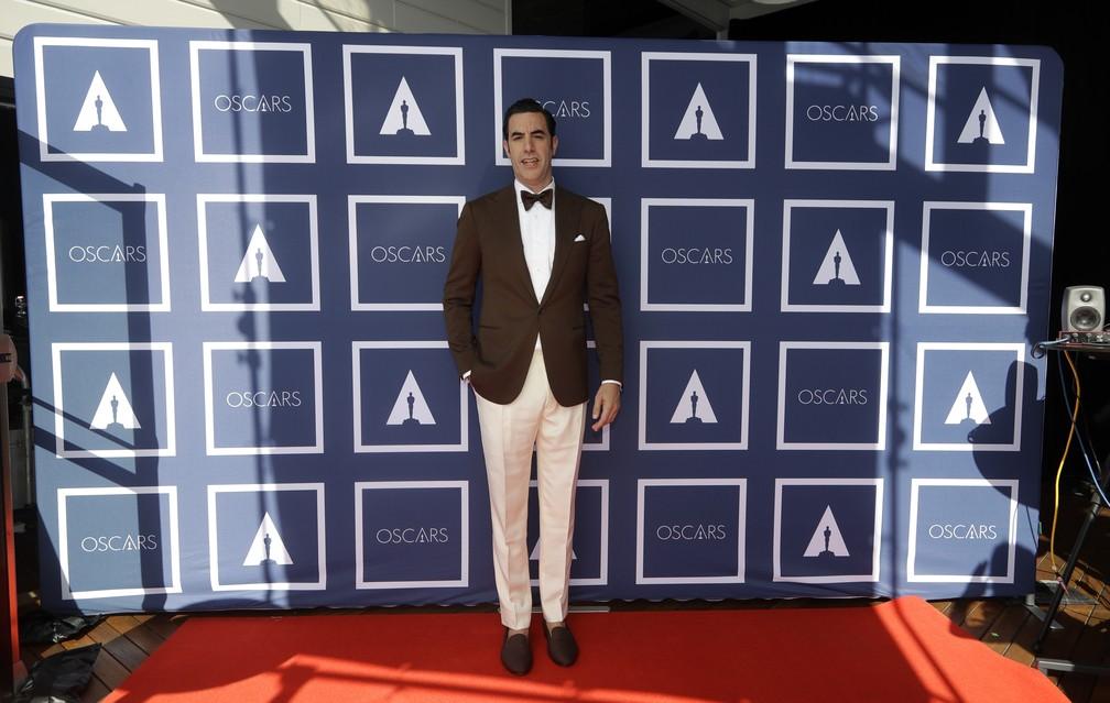 """Sacha Baron Cohen, indicado por """"Os 7 de Chicago"""", no Oscar 2021; Ator acompanha cerimônia direto da Austrália — Foto: AP Photo/Rick Rycroft"""