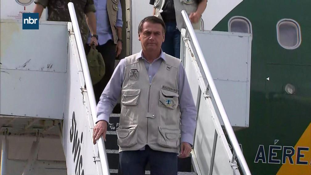 Presidente Jair Bolsonaro chega ao Aeroporto de Confins, em Belo Horizonte, de onde sairá para o sobrevoo na região do desastre — Foto: NBR/ Reprodução