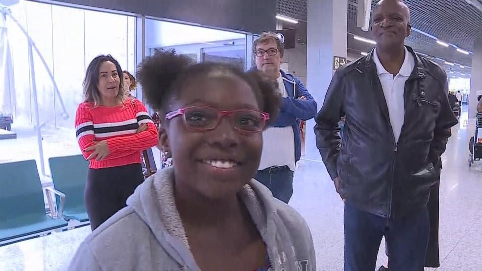 Keke, sequestrada pelo pai nigeriano, volta para casa após cinco meses — Foto: Reprodução/TV Globo