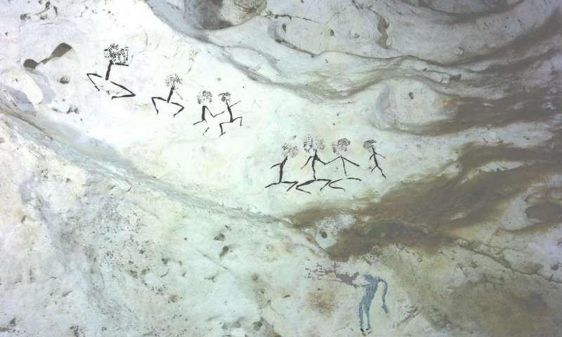 Outras figuras encontradas na caverna. Estima-se que tenham pelo menos 14 mil anos (Foto: Pindi Setiawan)