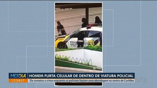Homem furta celular de dentro de carro da polícia e é preso