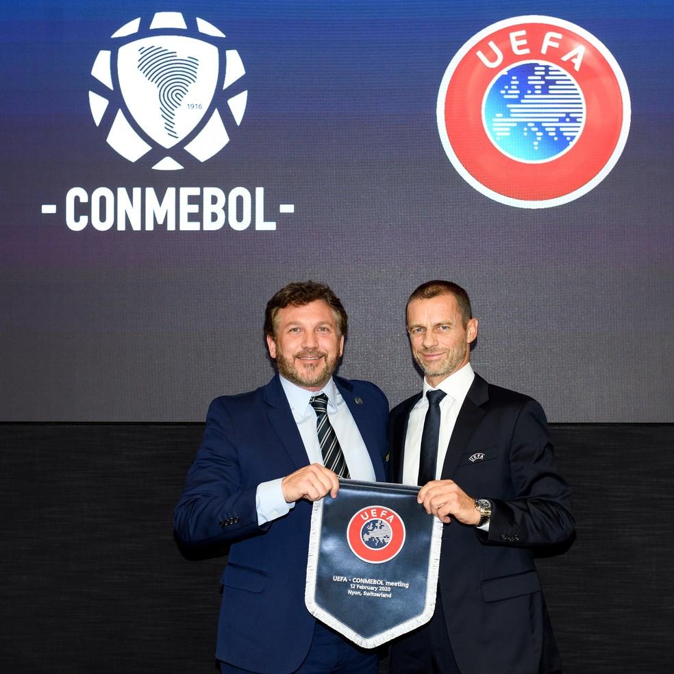 Alejandro Dominguez, presidente da Conmebol, e Aleksander Čeferin, presidente da Uefa, depois de reunião — Foto: Reprodução de Twitter
