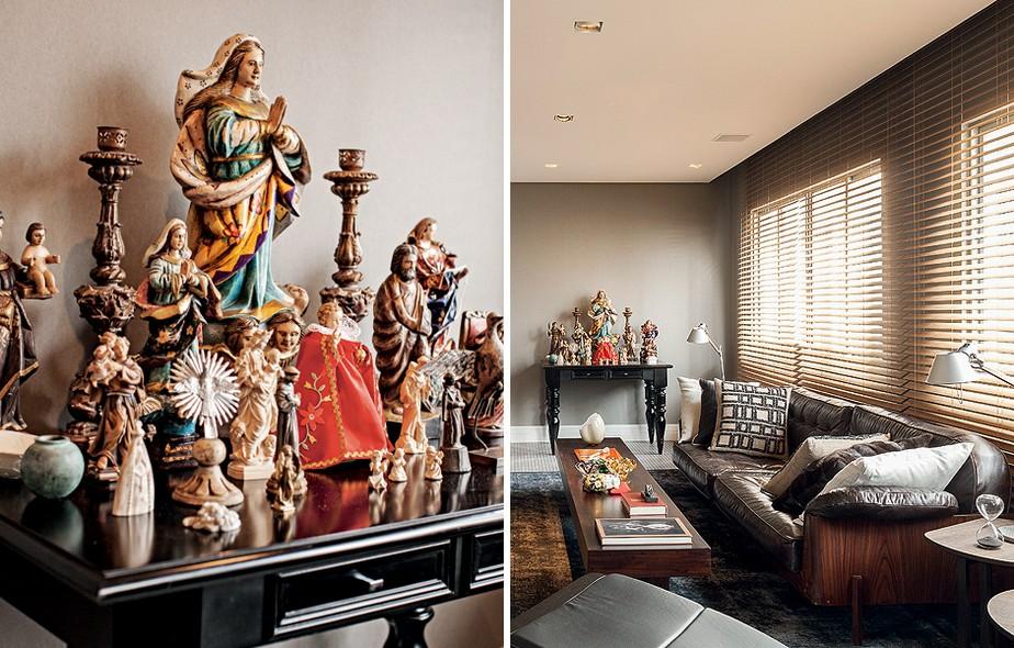 Sobre o aparador de madeira, ficam os santos barrocos e os castiçais do morador, o arquiteto Ricardo Caminada, garimpados em viagens pelo Brasil