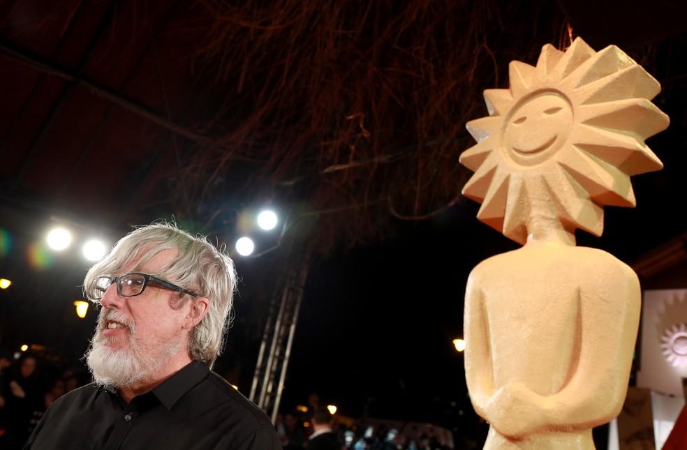 Otto Guerra cruza o tapete vermelho em noite de homenagem no Festival de Cinema de Gramado (Foto: Diego Vara/ Pressphoto)