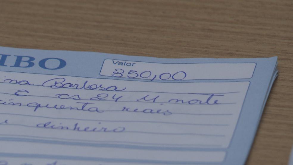 Recibo de pagamento de suposta vítima de golpe de venda de emprego no DF (Foto: TV Globo/Reprodução)