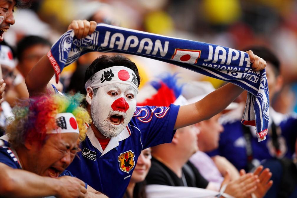 19 de junho - Torcedores do Japão comemoram vitória contra a Colômbia em Saransk, na Rússia (Foto: Jason Cairnduff/Reuters)