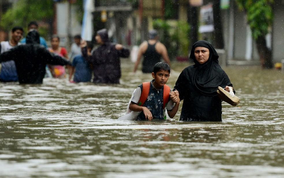 Sudeste asiático vive uma de suas piores inundações em décadas (Foto: Punit Paranjpe/AFP)