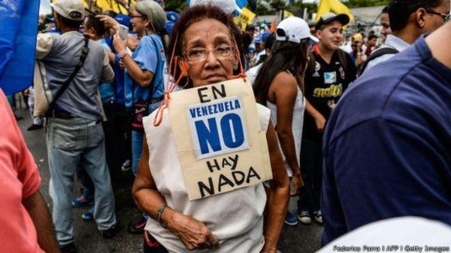 Manifestante venezuelano (Foto: Carlos Garcia Rawlins / Reuters)