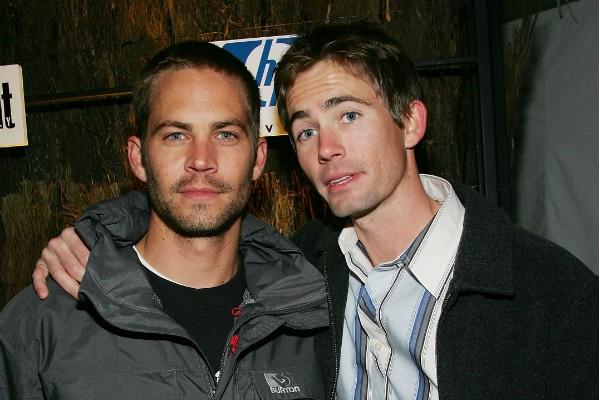 Caleb Walker em uma foto com o irmão Paul Walker (1973-2013) (Foto: Getty Images)