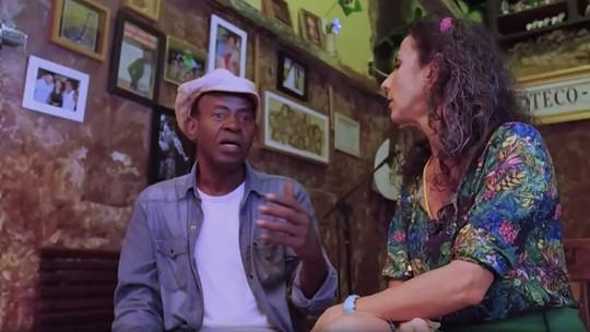 Maria bate papo com o ator Rai Alves e come uma pizza gigante no bairro da Saúde