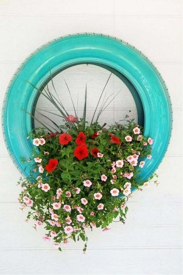 Pneu: reutilize o objeto para plantar flores e folhagens (Foto: Pinterest/Reprodução)