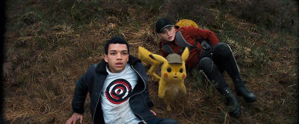 Justice Smith, Pikachu (dublado por Ryan Reynolds) e Kathryn Newton em cena de 'Pokémon: Detetive Pikachu' — Foto: Divulgação