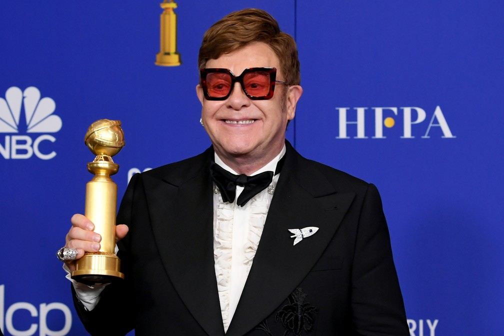 "Elton John vence o Globo de Ouro de melhor canção original por ""(I'm Gonna) Love Me Again"" do filme ""Rocketman"" — Foto: Kevin Winter/Getty Images North America/AFP"