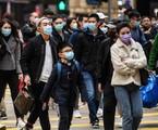 Chineses estão usando máscaras para evitar a propagação do Coronavírus | ANTHONY WALLACE / AFP