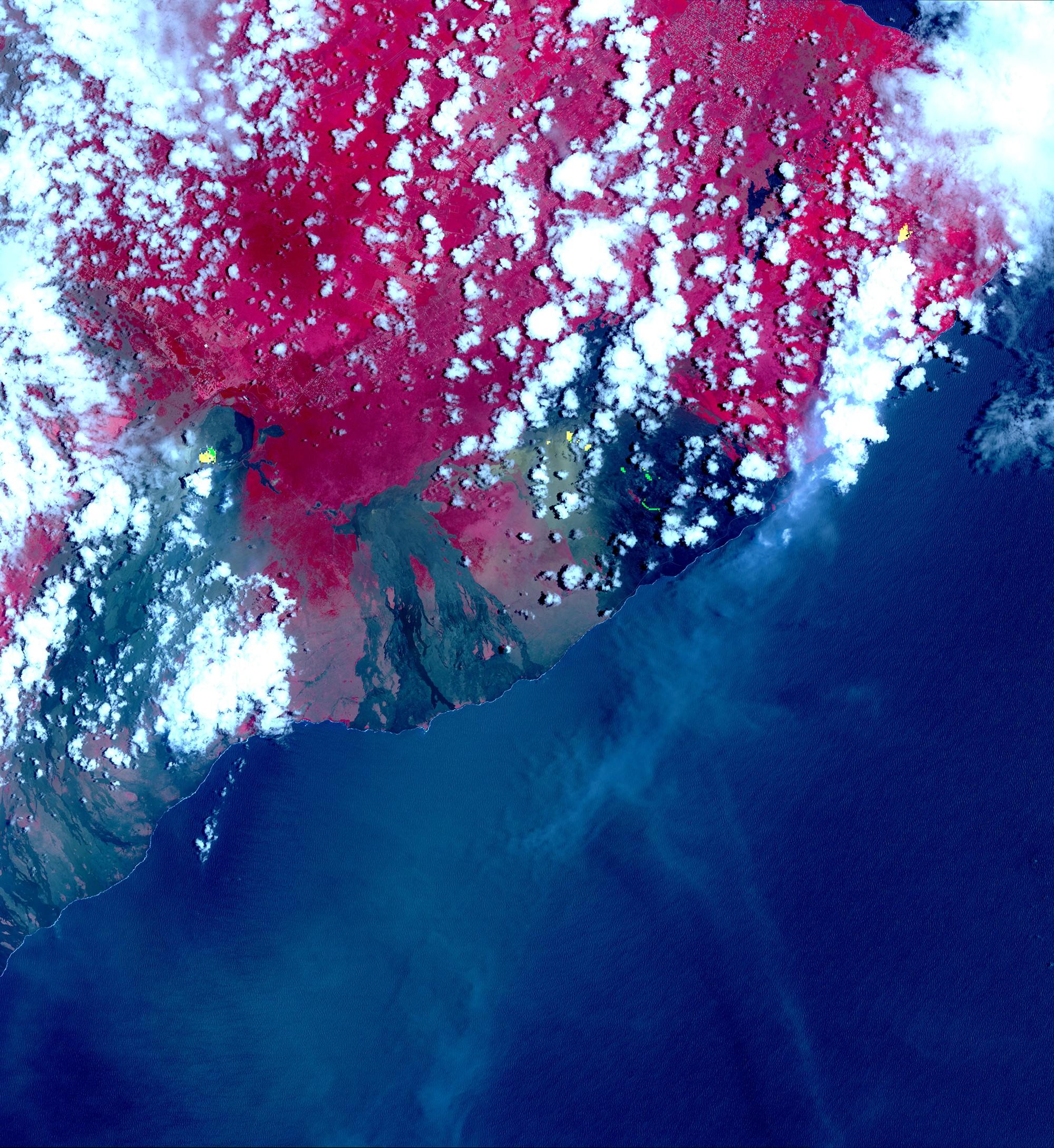 Pontos em amarelo representam o surgimento de novos centros de atividade eruptiva. Área em vermelho representa a vegetação local. (Foto: NASA/METI/AIST/Japan Space Systems, and U.S./Japan ASTER Science Team)