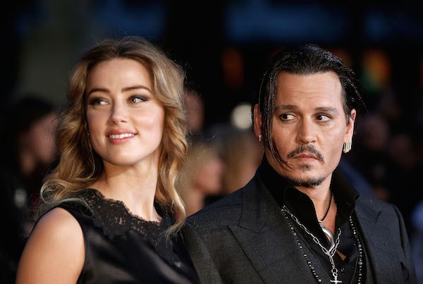 O ator Johnny Deppe e a atriz e modelo Amber Heard (Foto: Getty Images)