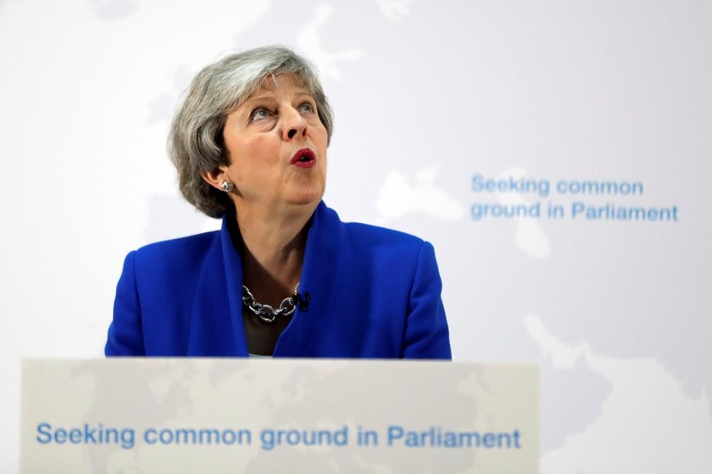 Theresa May apresenta pontos de nova proposta de retirada do Reino Unido da União Europeia — Foto: Kirsty Wigglesworth/Pool via Reuters