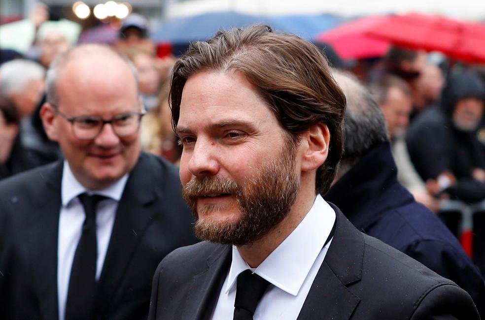 Intérprete de Niki Lauda no cinema, Daniel Brühl esteve no funeral do tricampeão — Foto: Reuters