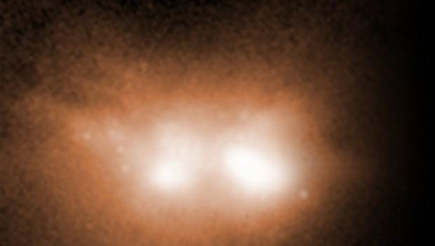 Imagem registrada pelo Telescópio Espacial Hubble mostra a fusão de duas galáxias (Foto: Espaço; galáxias)