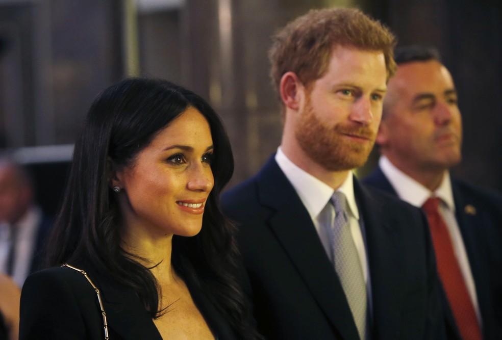 Prícipe Harry e  Meghan Markle são recepcionados por Malcolm Turnbull (Foto: AP Photo/Alastair Grant, Pool)