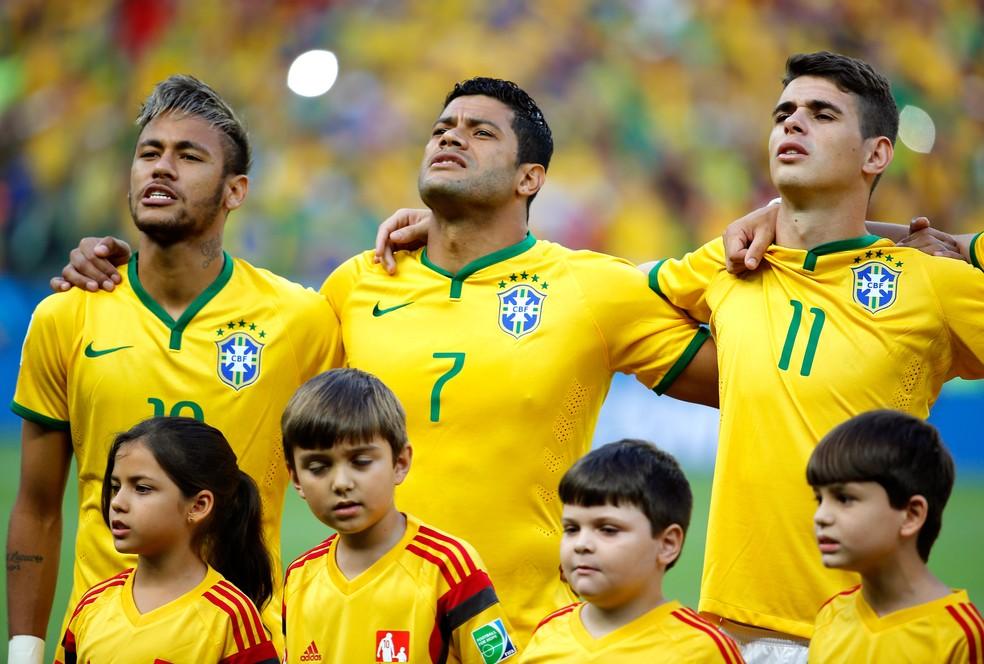 Neymar, Hulk e Oscar em partida válida pela Copa do Mundo do Brasil, em 2014 — Foto: Getty Images