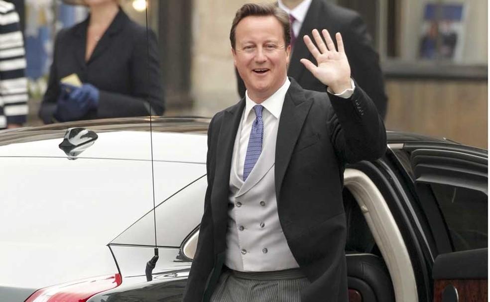 O então Primeiro-ministro britânico, David Cameron, chega para o casamento de William e Kate em 2011 (Foto: Phil Noble/Reuters)