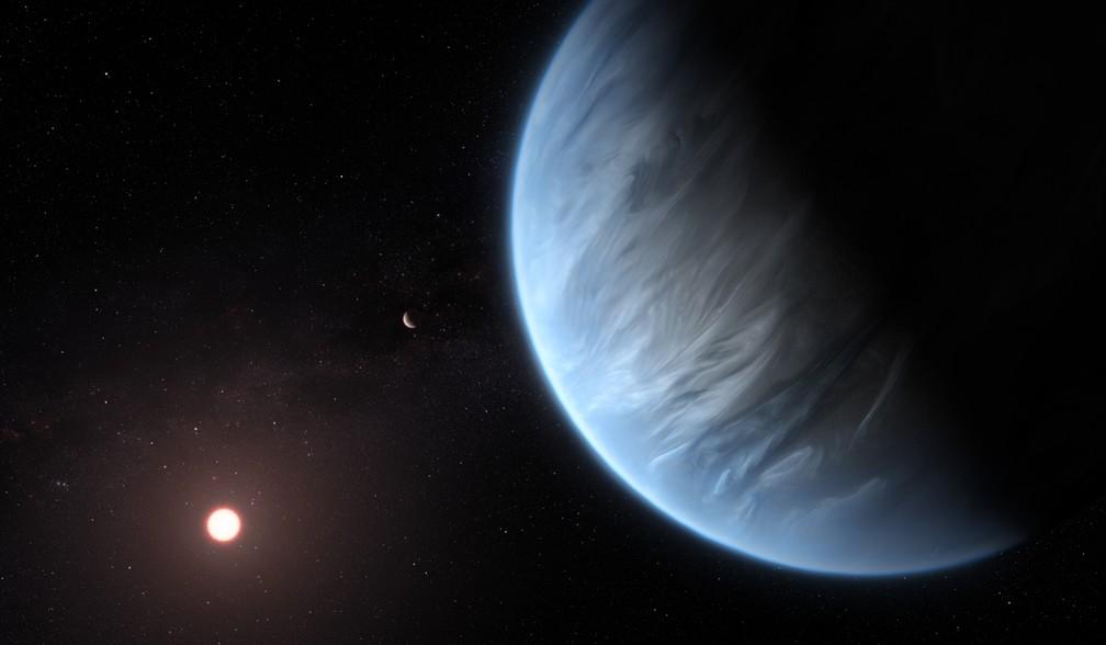 Representação artística do K2-18b, o único exoplaneta conhecido com água e temperatura que poderiam gerar vida — Foto: ESA / Hubble / via AFP Photo