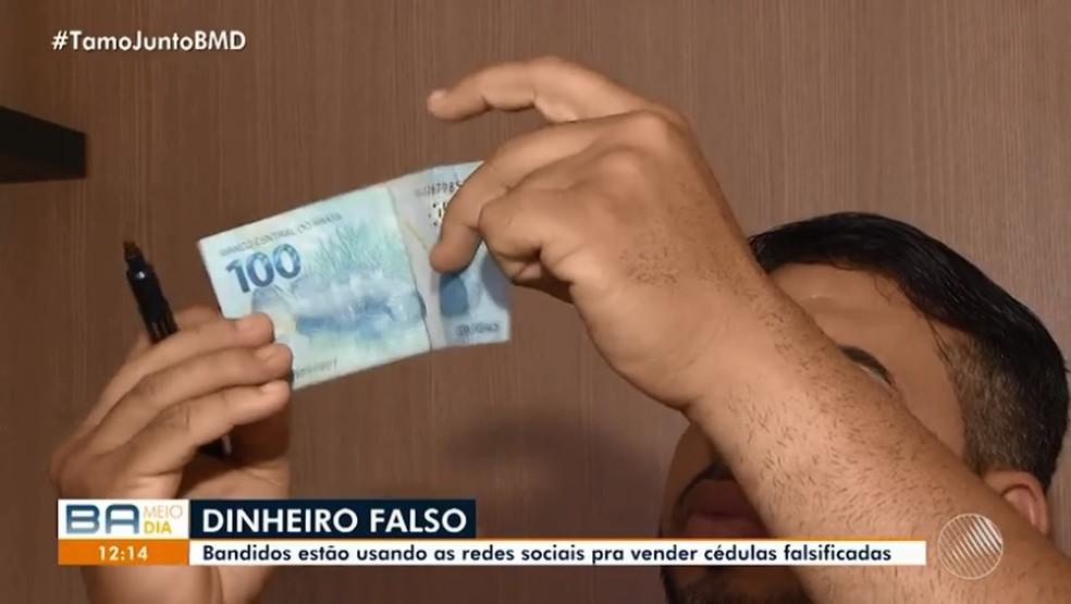 Polícia Federal orienta que as características das cédulas sejam observadas no contraluz  — Foto: TV Bahia