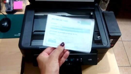 Como tirar cópias com a impressora Epson L355?