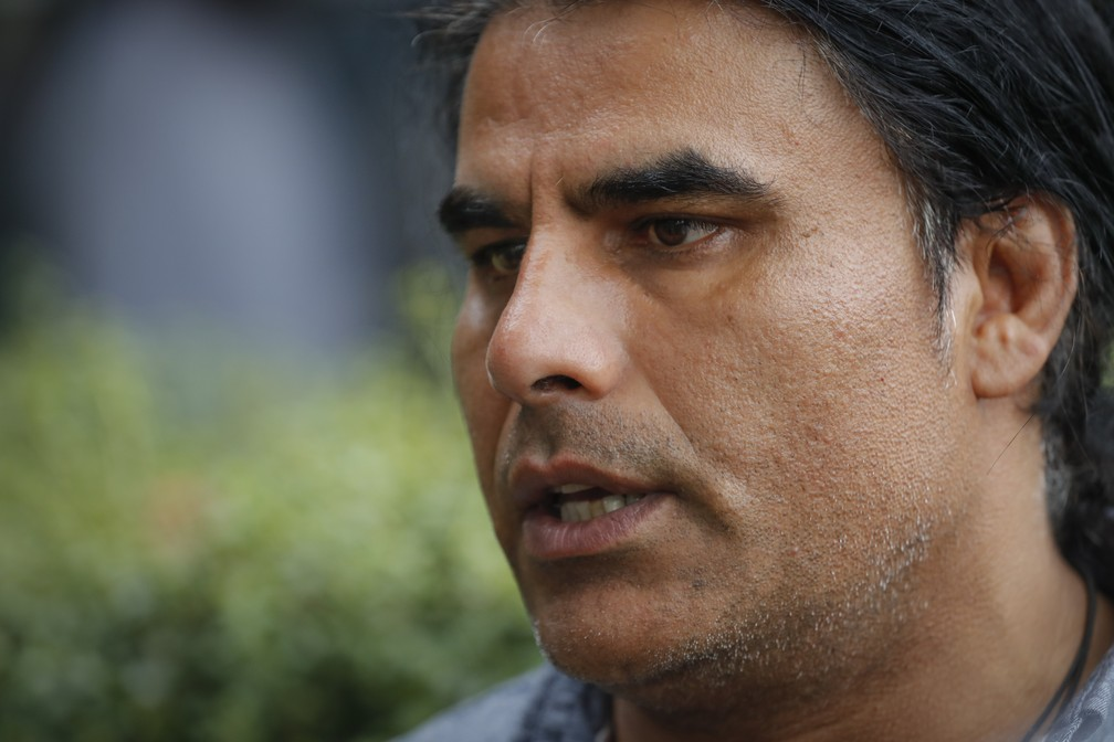 Abdul Aziz está sendo saudado como um herói na Nova Zelândia — Foto: Vincent Thian/AP