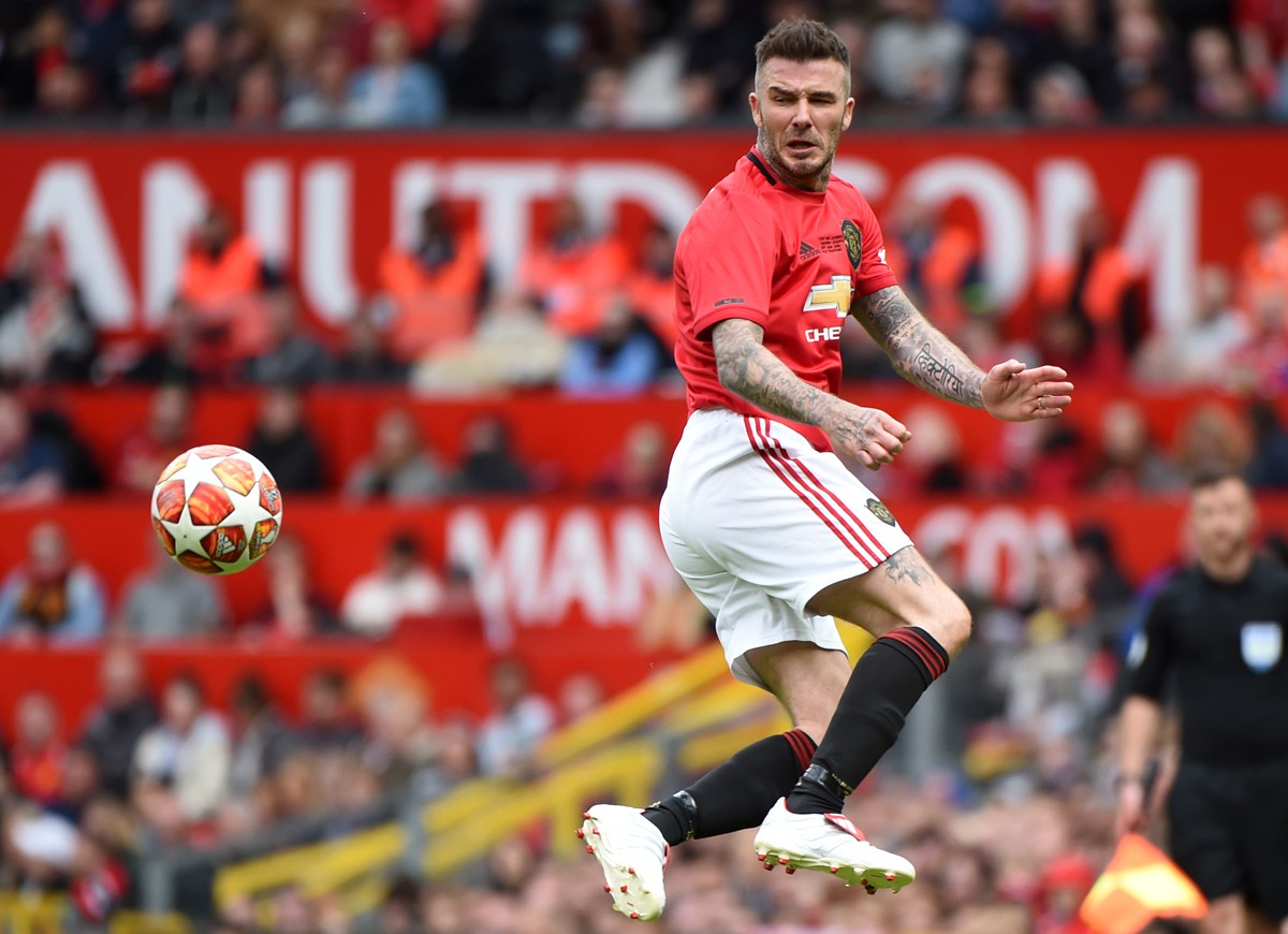 MANCHESTER, ENGLAND - MAY 26: David Beckham of Manchester United in action during the Manchester United '99 Legends and FC Bayern Legends at Old Trafford on May 26, 2019 in Manchester, England. (Photo by Nathan Stirk/Getty Images) (Foto: Getty Images)