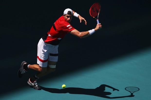 John Isner atual número nove do ranking da ATP faz a defesa do seu título (Foto: Al Bello / Getty Images)