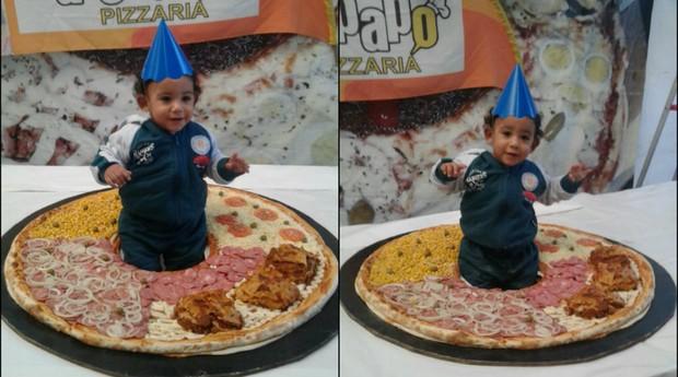 Dono da Pizzaria BatePapo colocou neto em pizza gigante para comemorar o Dia da Pizza (Foto: Divulgação)