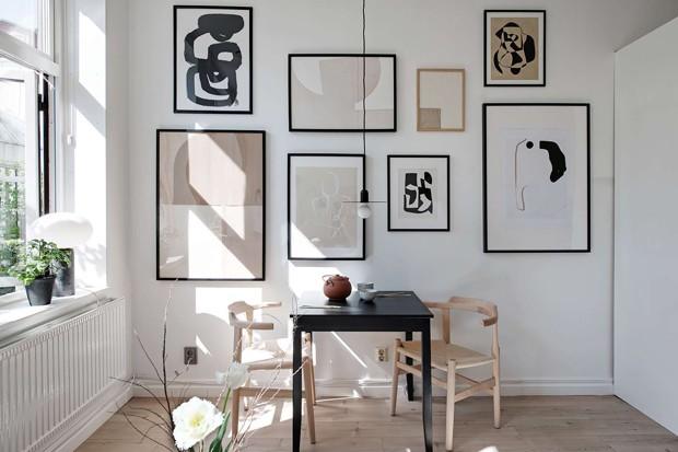 Décor do dia: sala de jantar pequena com quadros na parede (Foto: Divulgação)