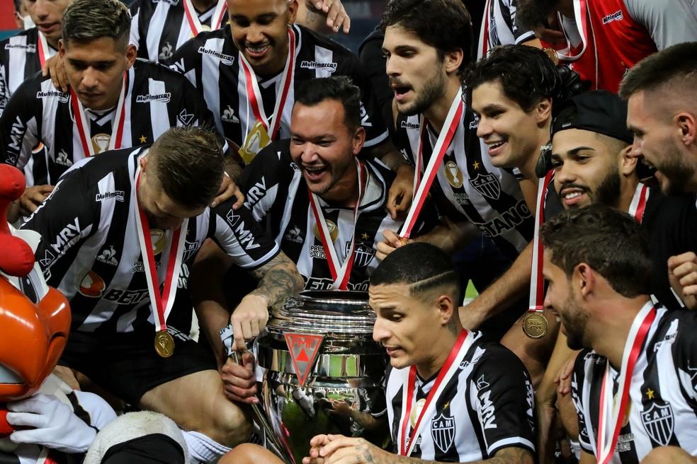 Jogadores do Atlético-MG comemoram o título — Foto: Fernando Moreno/AGIF