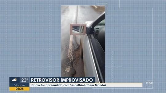 Motorista é multado e tem carro apreendido após improvisar retrovisor com espelho em SC